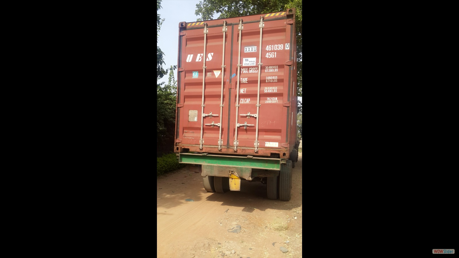 First container on the road with the green-house parts - early November 2015